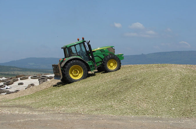 Triple A Beef - Farming tractor compressing silage